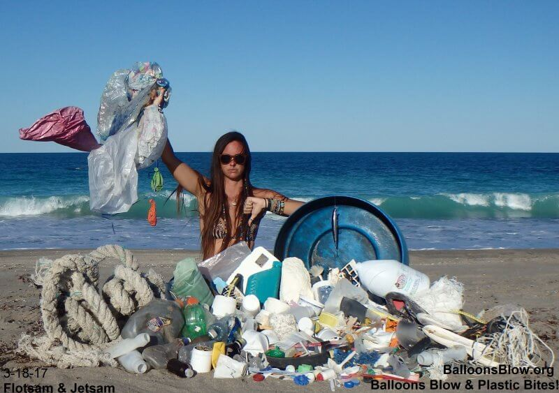Danielle on Beach with pile of plastic trash and ghost fishing gear